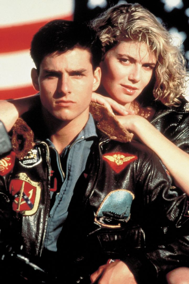 "Tom Cruise and Kelly McGillis on the set of ""Top Gun"" in 1986."