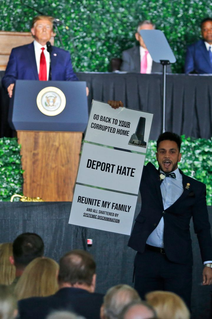 Virginia Del. Ibraheem Samirah (D) interrupts remarks by President Donald Trump in Jamestown, Virginia, on Tuesday.