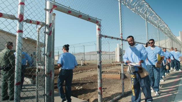 Inmates entering the GRIP training room at Avenal State