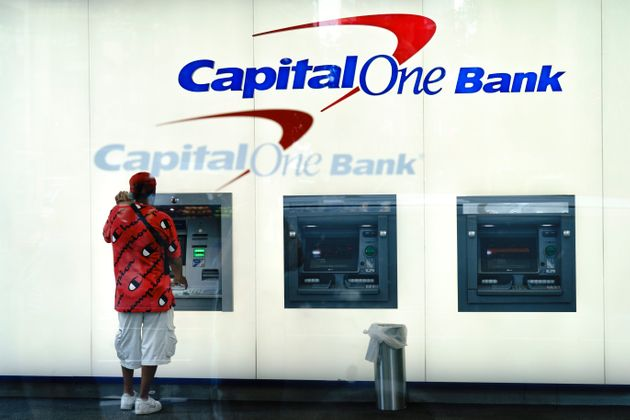 A man uses the ATM at a Capital One bank on July 30, 2019 in New York