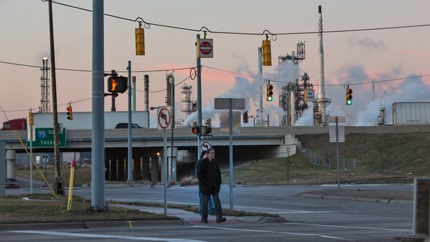 Workers leave the Marathon Refinery in Oakwood Heights, the southernmost neighborhood of Detroit, Michigan. (Photo by Julie Dermansky/Corbis via Getty Images)