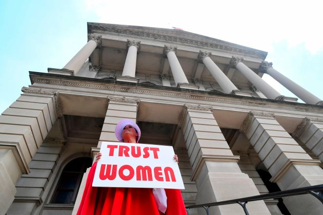 Activist Tamara Stevens with the Handmaids Coalition of Georgia stands outside the Georgia Capitol after...