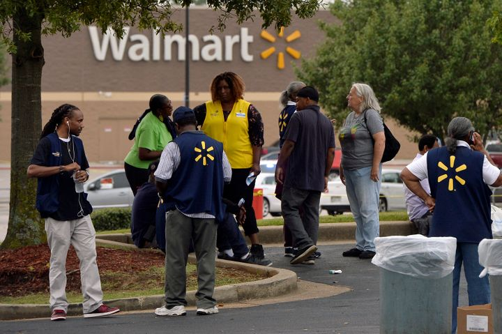 Employees gather in a nearby parking lot after a shooting at a Walmart store Tuesday, July 30, 2019 in Southaven, Miss.