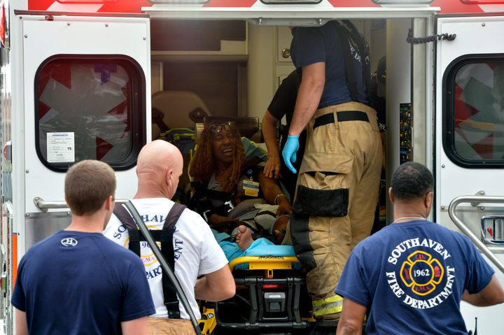 A Walmart employee receives medical attention after a shooting at the store, Tuesday, July 30, 2019, in Southaven, Miss.