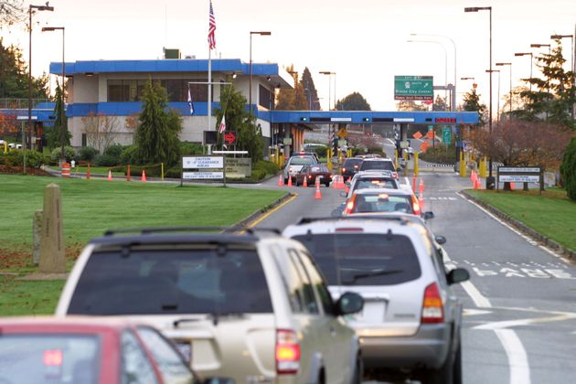 Vehicles line up at the Canada-U.S. Peace Arch border crossing in