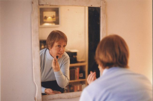 Dan Kellum's mom putting on makeup in his first New York apartment in 2000.