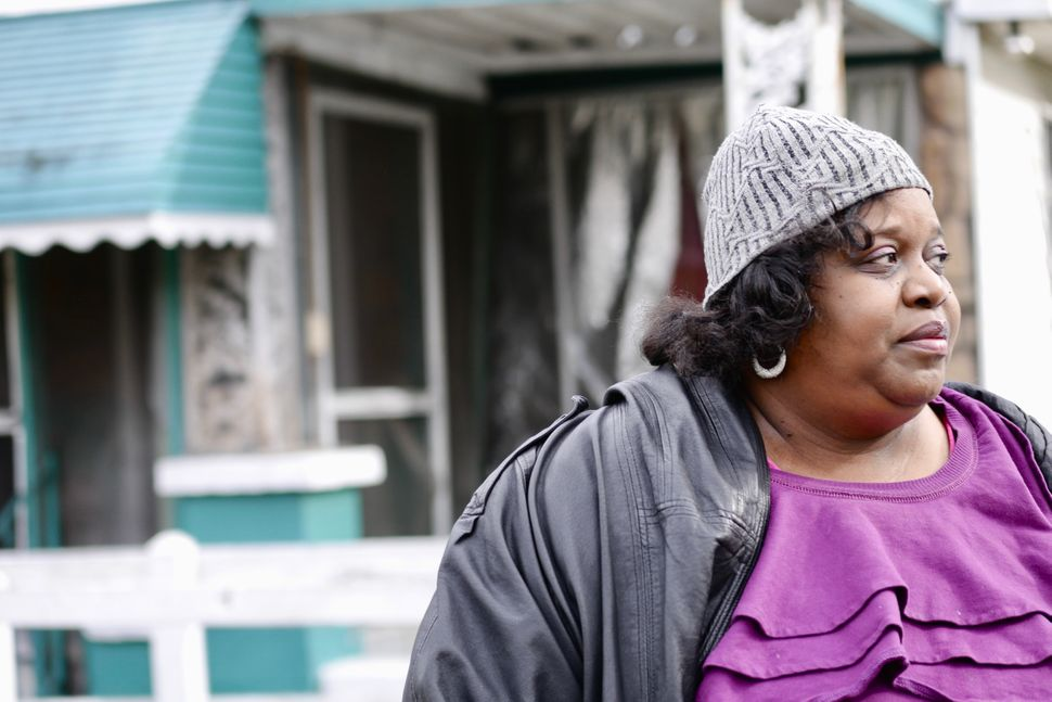 Activist Keisha Brown in front of her house in Harriman Park in Birmingham, Alabama.