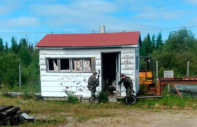 RCMP officers search homes and buildings in the Gillam,