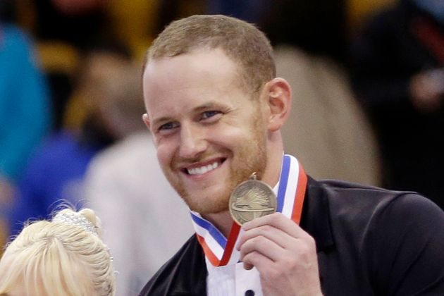 Bronze medalist John Coughlin smiles during a 2014 award ceremony at the U.S. Figure Skating Championships...