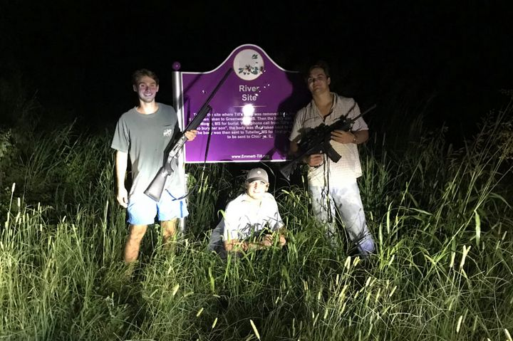 From left to right, Ole Miss students Ben LeClere, John Howe, and Howell Logan posing with guns by the bullet-ridden plaque m