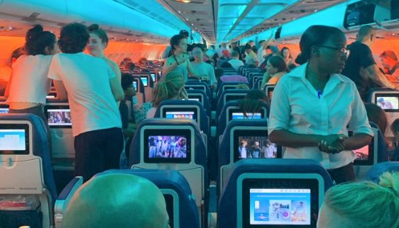 Passengers mill about an Air Transat airplane stuck on the tarmac in Rome, in this image posted to Twitter by user Ashley Gamble.