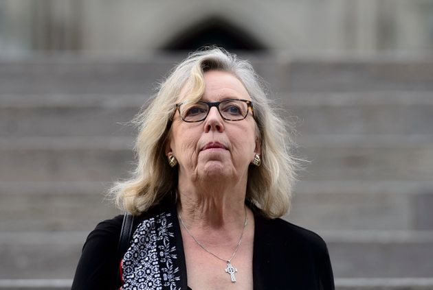 Green party leader Elizabeth May makes her way from Parliament Hill in Ottawa on June 18,