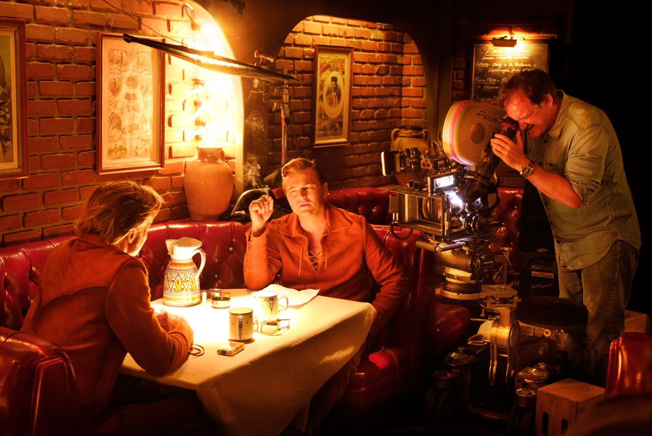 """Quentin Tarantino shooting a """"Once Upon a Time in Hollywood"""" scene with Brad Pitt and Leonardo DiCaprio."""