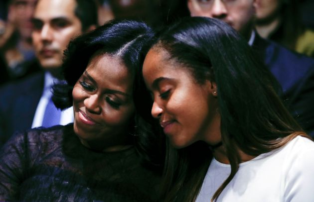 Michelle Obama with her daughter Malia during U.S. President Barack Obama's farewell address at McCormick...