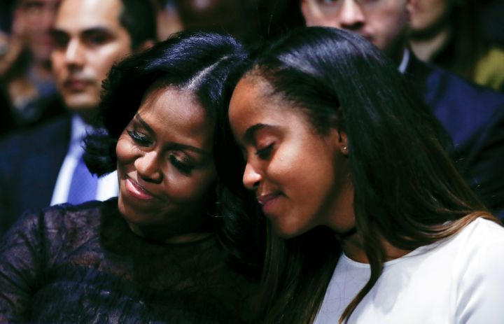 Michelle Obama with her daughter Malia during U.S. President Barack Obama's farewell address at McCormick Place in Chicago on Jan. 10, 2017.