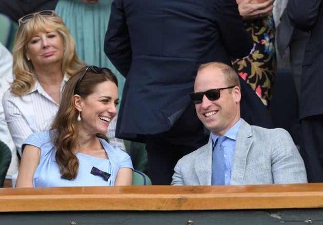 The Duke and Duchess of Cambridge smile during Men's Finals Day of the Wimbledon Tennis Championships...