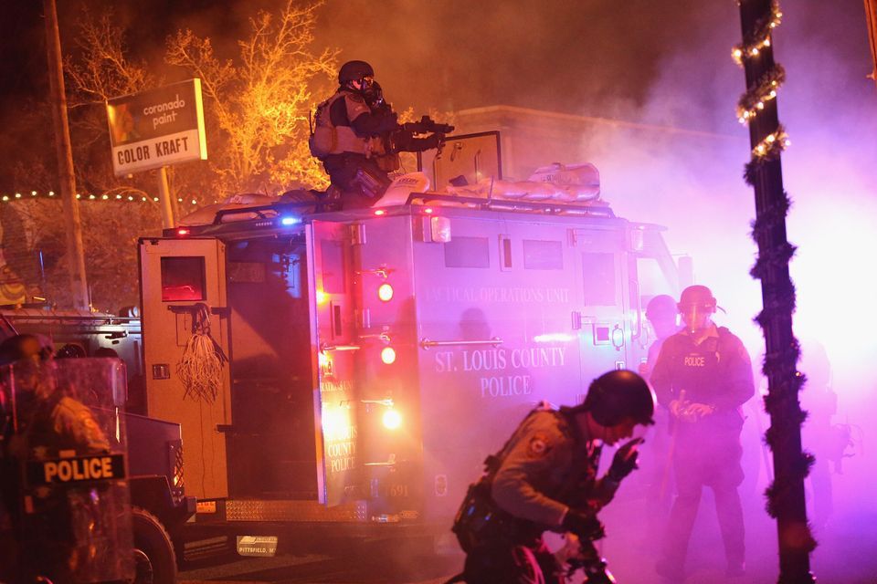 FERGUSON, MO - NOVEMBER 24: Police confront protestors after rioting broke out following the grand jury...