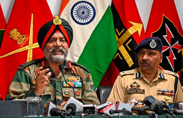 Indian Army General Officer Commanding (GOC) 15 Corps KJS Dhillon (L) speaks next Police Chief Dilbagh...
