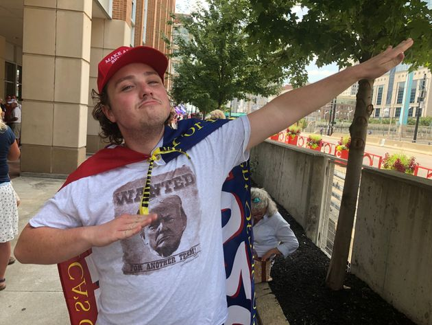 Austin Greg poses for a photo outside a Trump rally in Cincinnati on Aug. 1,