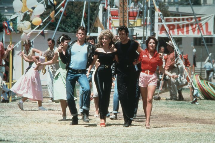 """Grease"" followed the romance between Danny Zuko (John Travolta) and Australian transfer student Sandy Olsson (Olivia Newton-"