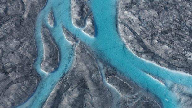 In this image taken on Thursday Aug.1, 2019 large rivers of melting water form on an ice sheet in western Greenland and drain into moulin holes that empty into the ocean from underneath the ice. The heat wave that smashed high temperature records in five European countries a week ago is now over Greenland, accelerating the melting of the island's ice sheet and causing massive ice loss in the Arctic. (Photo via Caspar Haarløv, Into the Ice via AP)