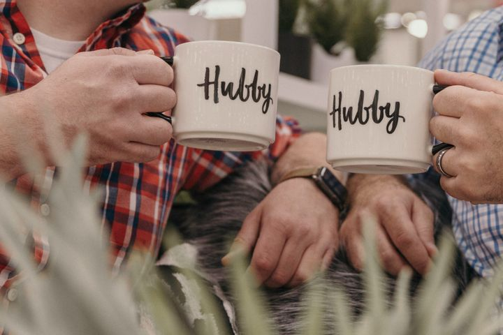 "The couple's matching ""hubby"" mugs."