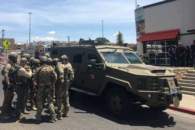 Law enforcement officers outside the El Paso Walmart where the mass shooting