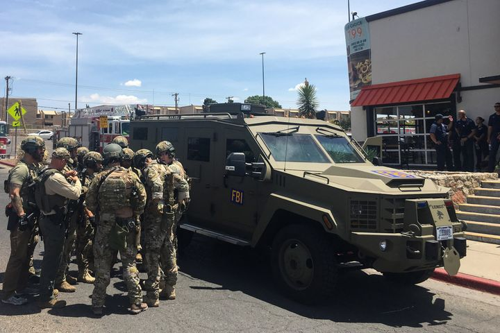 FBI authorities stand outside near an El Paso Walmart that has left multiple people dead.