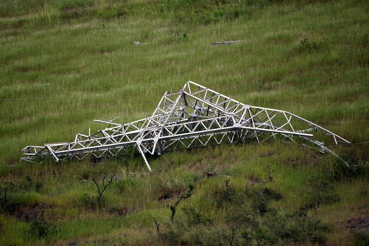 A twisted power distribution line tower is crumpled on the ground on Oct. 28, 2017, after the passing of Hurricane Maria in G