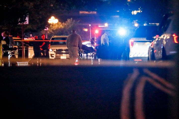 Bodies are removed from the scene of a mass shooting early Sunday in Dayton, Ohio.