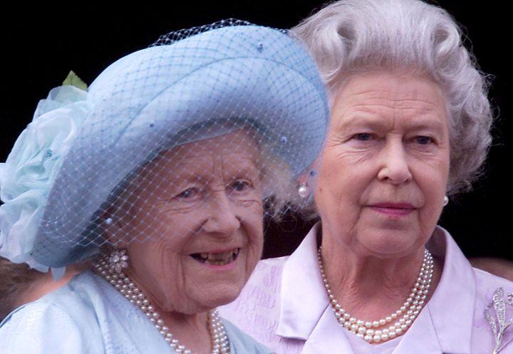 The Queen Mother, left, celebrates her 100th birthday with her daughter, Queen Elizabeth II, in 2000.