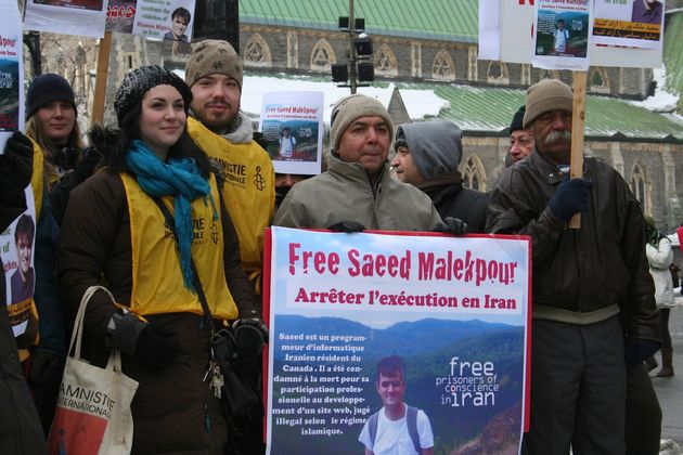 This 2012 photo shows supporters demonstrating for the release of Saeed Malekpour, in Phillips Square in Montreal.