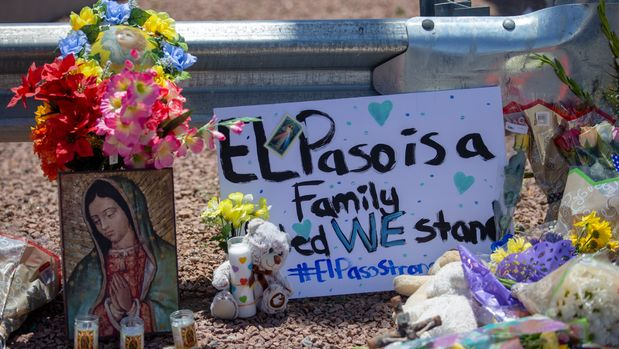 Flowers and a Virgin Mary painting adorn makeshift memorial for the victims of Saturday mass shooting at a shopping complex in El Paso, Texas, Sunday, August 4, 2019. (AP Photo/Andres Leighton)