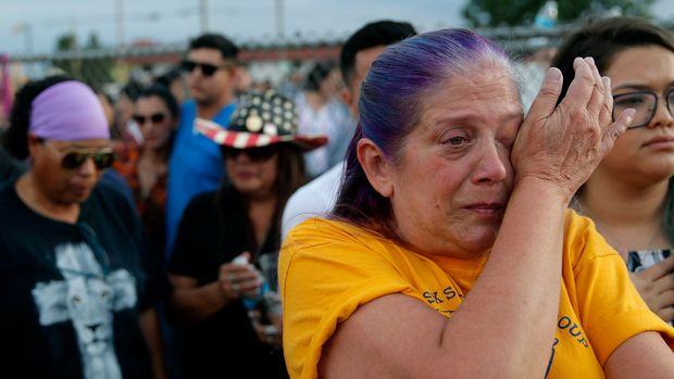 "Cathe Hill wipes tears from her eyes during a vigil for victims of Saturday's mass shooting at a shopping complex Sunday, Aug. 4, 2019, in El Paso, Texas. ""There's no such thing as a stranger here in El Paso,"" said Hill about the impact the shooting had on the community. (AP Photo/John Locher)"