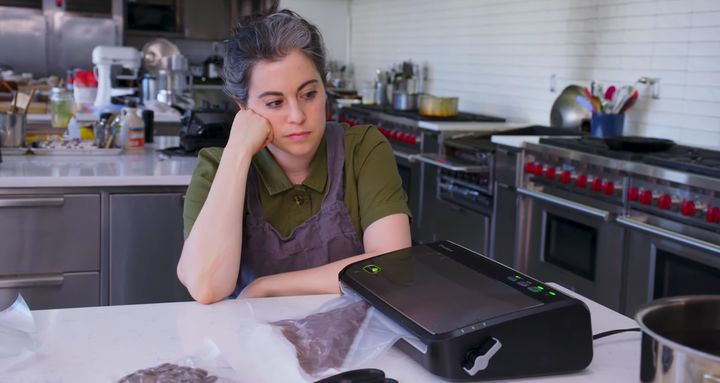 "After experiencing a setback, Claire Saffitz of ""<a href=""Pastry Chef Attempts To Make a Gourmet Twinkie"" target=""_blank"" rel=""noopener noreferrer"">Gourmet Makes</a>"" oversees her chocolate tempering process for making Twix."
