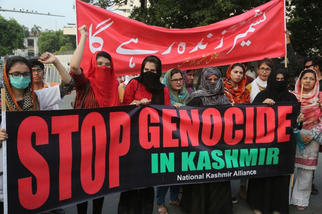 Pakistanis protest against India and express support and solidarity with Kashmiri people, in Lahore,...