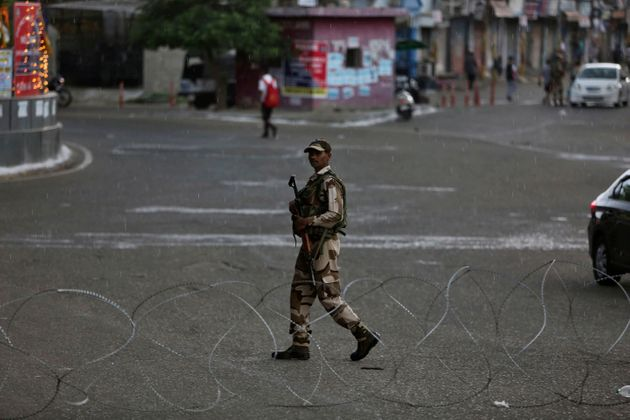 An paramilitary soldier guards during security lockdown in Jammu, Aug. 5,