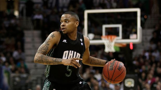 Ohio's D.J. Cooper drives the ball downcourt during the first half of an NCAA college championship basketball game against Akron in the Mid-American Conference tournament Saturday, March 16, 2013, in Cleveland. (AP Photo/Tony Dejak)