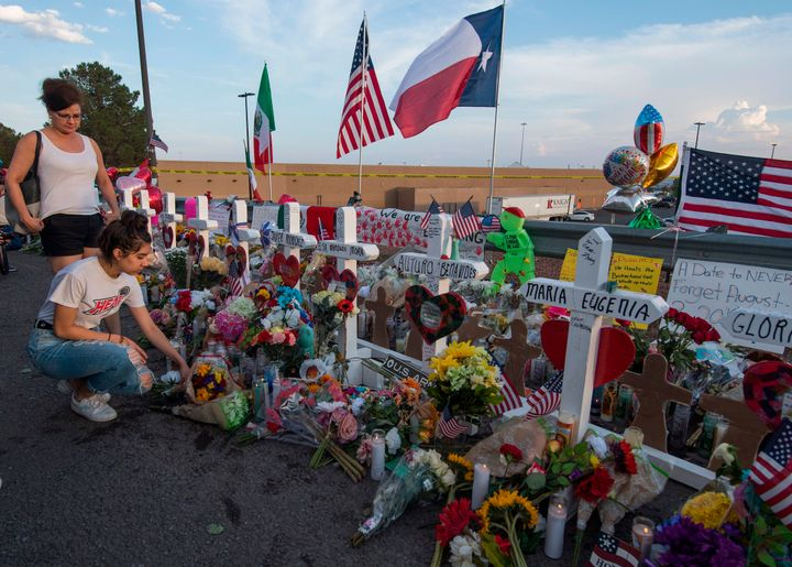 Mourners visit a memorial for the victims of the mass shooting in El Paso, Texas.