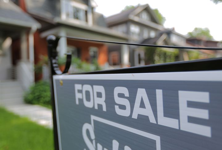 A sign advertises a house for sale in midtown Toronto, July 12, 2017.