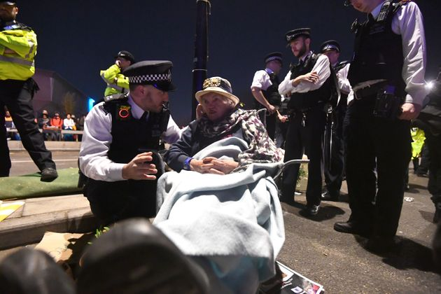 A police officer speaks to an older woman on Waterloo Bridge during the protests in London in