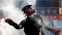 China advierte a los manifestantes:
