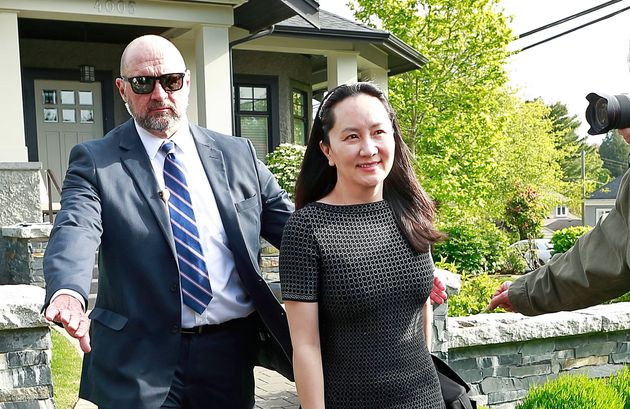 Meng Wanzhou is escorted by security from her home in Vancouver on May 8,