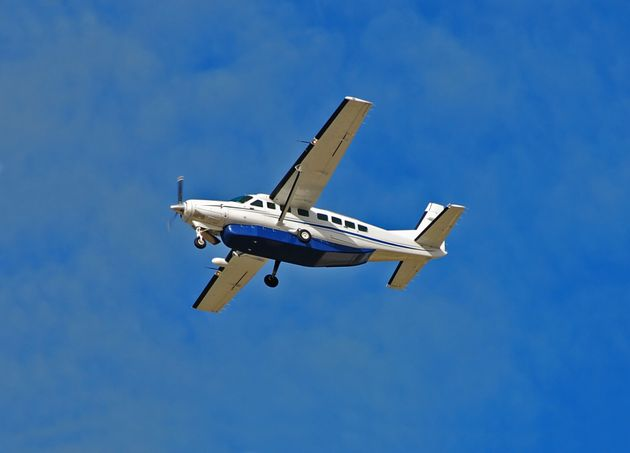 A Cessna 208 Caravan airplane is seen flying in this stock photo. This plane model was involved in a...