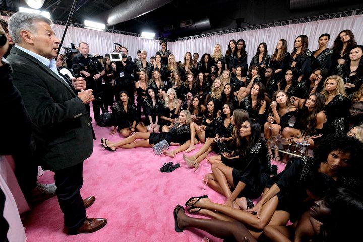 Ed Razek speaks to Victoria's Secret runway models backstage during the 2018 Victoria's Secret Fashion Show.