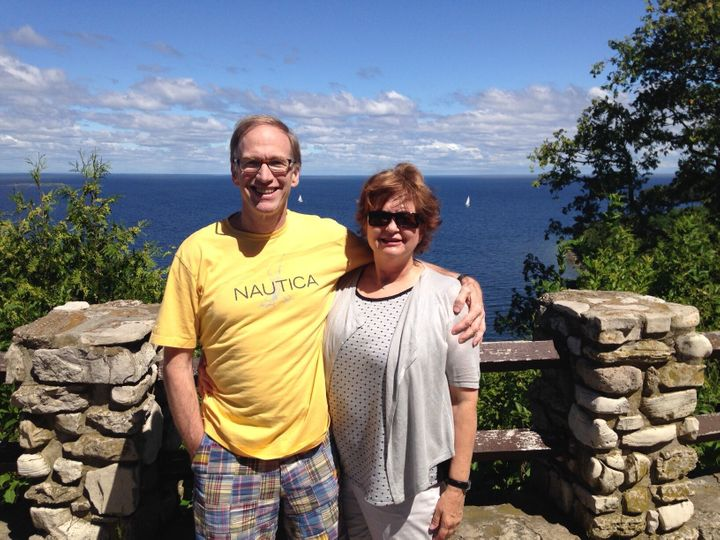 Posing on a scenic Lake Michigan overlook during one of our travel adventures.