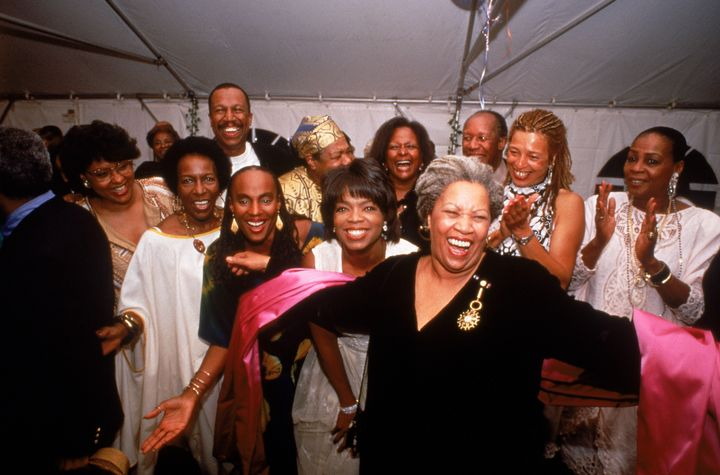 Nobel laureate Toni Morrison accepting the applause of partygoers Susan Taylor, Rita Dove, Oprah Winfrey, Angela Davis, Maya Angelou and others.