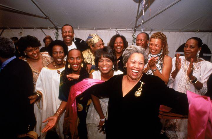 Nobel laureate Toni Morrison accepting the applause of partygoers Susan Taylor, Rita Dove, Oprah Winfrey, Angela Davis, Maya Angelou and others.