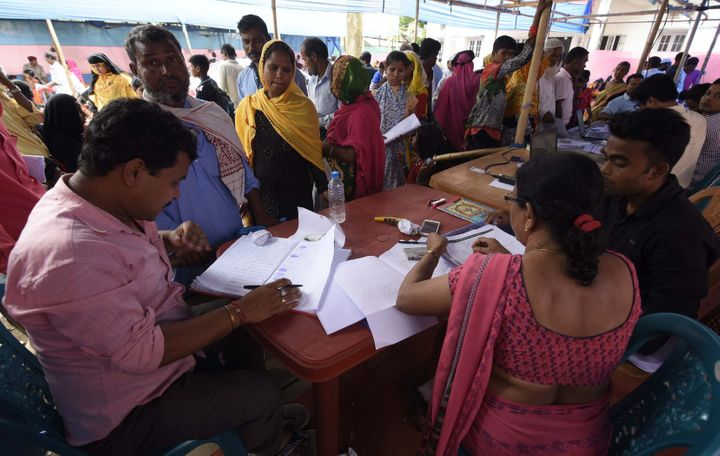 Assam State National Register of Citizens (NRC) officials check documents of residents during an appeal hearing against the non-inclusion of their names in the citizens register at an NRC office in Nagaon District of Assam, on June 3, 2019.