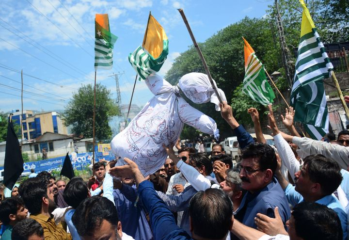 Pakistani Kashmiris carry an effigy of Indian Premier Narendra Modi during an anti-Indian protest in Muzaffarabad, capital of